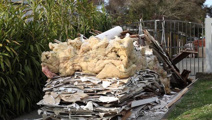 Skip company dumps load of trash on couple's driveway