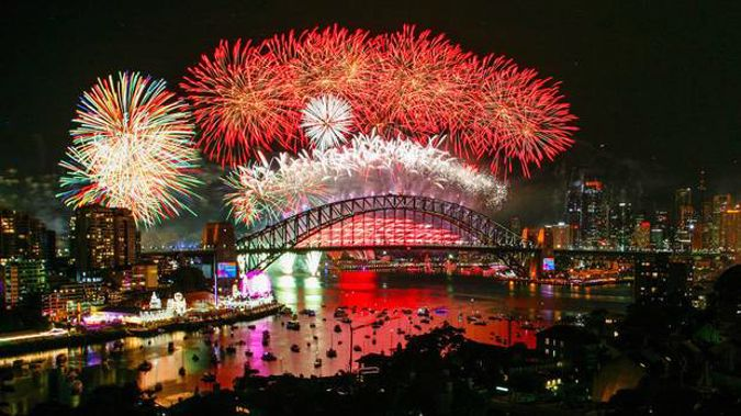 Fireworks explode over the Sydney Harbour Bridge during the midnight display on New Year's Eve on Sydney Harbour. Photo / Getty