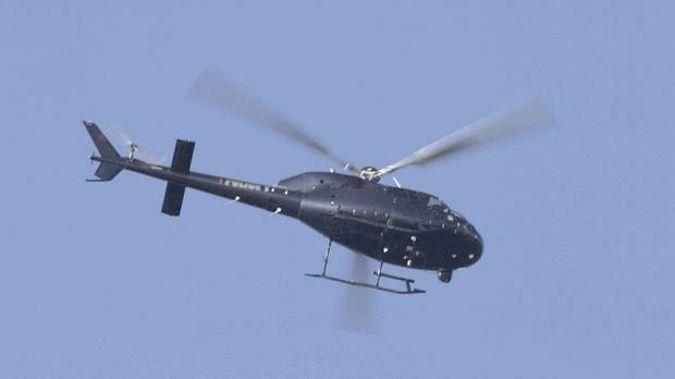 A police helicopter was in a near collision with a drone above Auckland last night. Photo / File