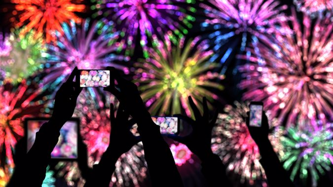 People are spending more time on their phones on New Year's Eve. (Photo / Getty)