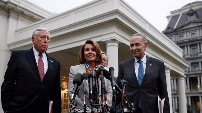 House Democratic leader Nancy Pelosi after meeting US President Donald Trump. With her are whip Steny Hoyer, left, and Senate Democratic leader Chuck Schumer. (Photo / AP)