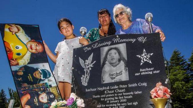 Keiarah Nathan-Craig, 9, left, Teresa Smith-Craig and Nana Anne Craig at Isachaar's grave at Mangaroa Cemetery near Hastings where his pounamu was stolen from. (Photo / Paul Taylor)