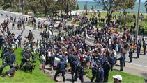 Nazi salutes and police scuffles at Melbourne far right rally