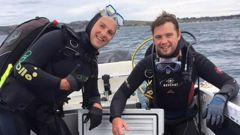 Matt, left, and Chris Williams were surprised to resurface and find their boat had gone. (Photo / Supplied)