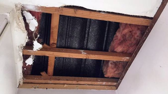 The hole left in the ceiling of 82-year-old Greenlane woman Heidrun Leonard's house by two people who scammed her out of $8800. (Photo / Ben Leahy)