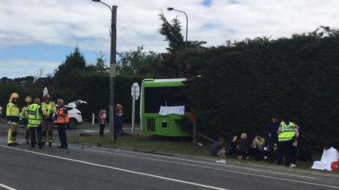 A car failed to give way at an intersection, with a commercial bus swerving into a hedge to avoid it.