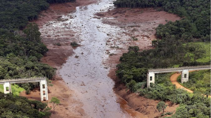 The dam collapsed yesterday, engulfing a nearby village in millions of cubic metres of mining waste. (Photo / AP)