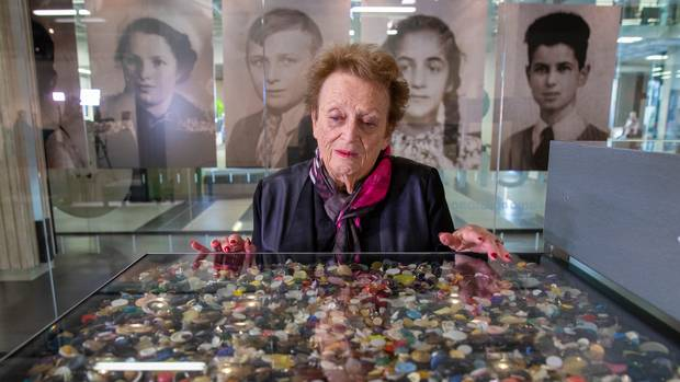 Pictured is holocaust survivor Inge Woolf viewing some of the 1.5 million buttons, representing the number of Jewish children murdered in the Holocaust. Photo / Mark Mitchell