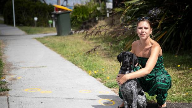 AJ Hodges with her dog Wilson on Clayburn Rd in Glen Eden, where a number of people were injured after a collision with a car outside a party on Sunday morning. (Photo / Jason Oxenham)