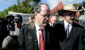 Then National Party leader Don Brash leaves Te Tii Marae at Waitangi in 2004 after he had dirt thrown at him. (Photo/NZ Herald)