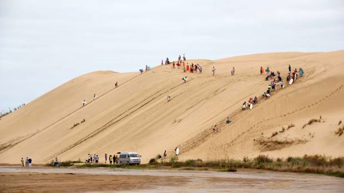 The sand dunes at Te Paki are a popular attraction for tourists who are encouraged to ride boards down the slopes. Photo / File
