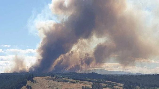 Three helicopters have been tasked to tackle the blaze, along with fire crews from throughout the area. (Photo / Nelson Weekly)