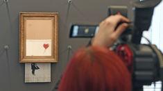 Banksy's shredded art work goes back on display
