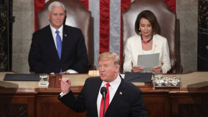 President Donald Trump, with Speaker Nancy Pelosi and Vice President Mike Pence looking on, delivers the State of the Union address. Photo / Getty Images