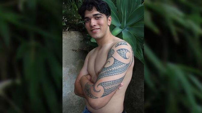 Marli Atu, 16, has been forced to cover up his traditional tatau tattoo at Glenfield College. (Photo / Graham Hooper)