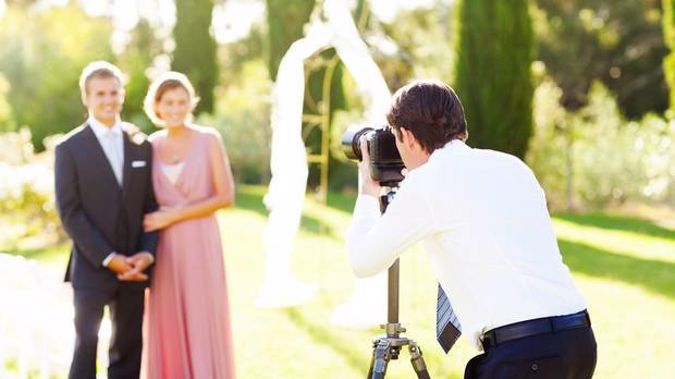 A Christchurch woman says a photographer who objected to her ad seeking a student to take her wedding photos for free urged people to whack her. Photo / Getty Images