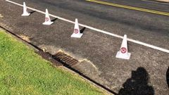 An East Auckland local was outraged after a person illegally put out cones to block access to public parking down her street. (Photo / Supplied)