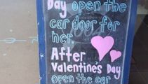 Restaurant defends sign seen as promoting violence against women