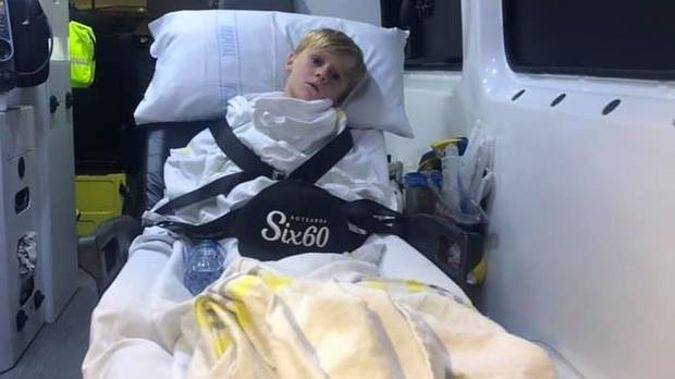 Riley Heath on the way to Starship Hospital after suffering a severe asthma attack triggered by smokers at the Six60 concert. (Photo / Supplied)