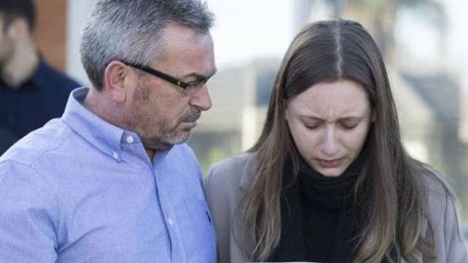 A heartbroken Sarah Ristevski stands by her father Borce as they plead for assistance in finding her mum Karen. (Photo / news.com.au)