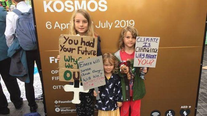 Finn, 10, Brodie, 7, Tara, 3 at today's climate strike in Wellington. Photo / Devon Bolger