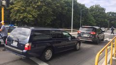 The hearses wait patiently for their terrible assignment at the Deans Avenue cordon. (Photo / Newstalk ZB)