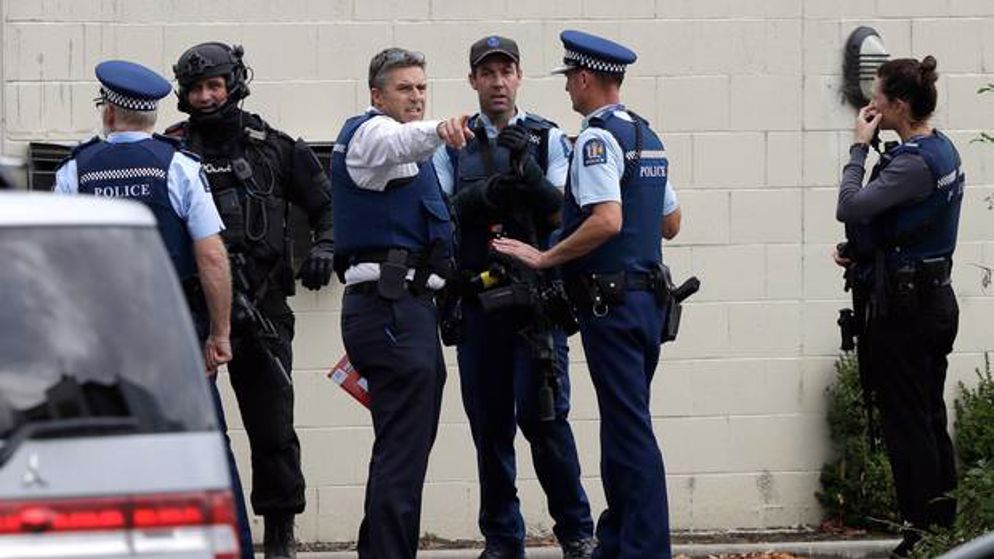 Police stand outside a mosque in central Christchurch following the terror attack. Photo / AP
