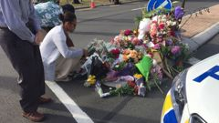 Christchurch residents laying flowers outside the Al Noor Mosque cordon. Photo / Amber Allott.