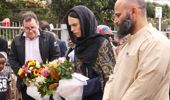 Prime Minister Jacinda Ardern lays flowers while finance minister Grant Robertson looks on at the Kilbirnie Mosque on March 17, 2019 in Wellington, New Zealand. Photo / Getty Images
