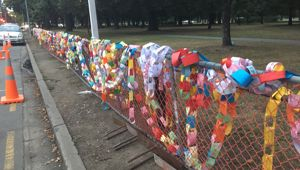 Paper chains and notes of love left for victims on Deans Ave