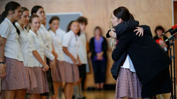 Prime Minister Jacinda Ardern hugs and consoles a student during a visit to Cashmere High School in Christchurch today. (Photo / AP)