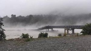 The Waiho bridge has been taken out by the flooding. (Photo / Anna Eatwell)