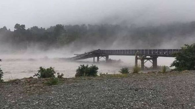 The bridge over the Waiho River at Haast washed away about 4.30pm.