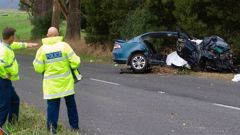 Police at the scene of the Tirohanga Rd crash. Photo / Stephen Parker