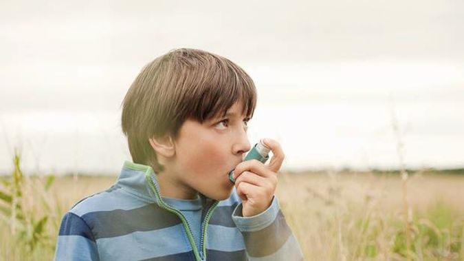 Just five doses of some types of inhalers can have the same effect as a 14km car journey. Photo / Getty Images