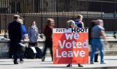 A supporter of Brexit holds a sign outside the Houses of Parliament in Westminster. Photo / AP