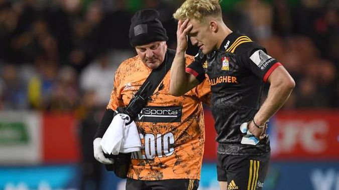 A dejected Damian McKenzie after being injured against the Blues. Photo / Photosport