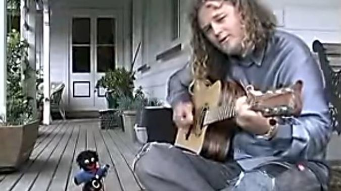 """New Zealand singer songwriter Craig Smith in a still from his video for his children's song """"Gollywog Song"""". (Photo / YouTube)"""
