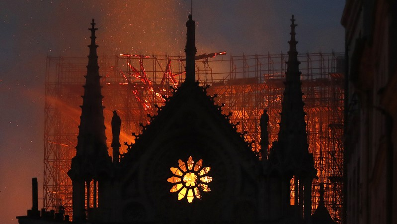 The famous Paris cathedral has been virtually destroyed in a massive blaze - its roof and spire have collapsed.