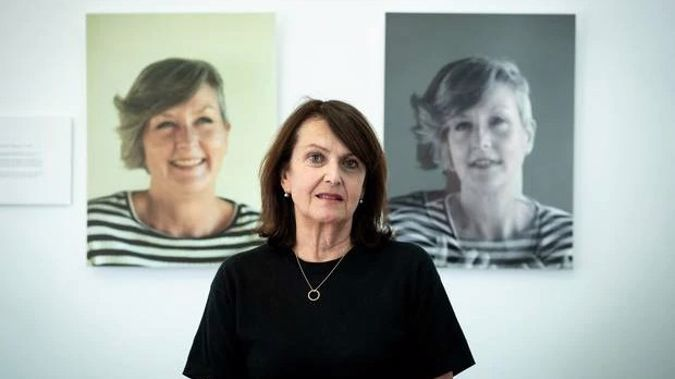 Sweet Louise chief executive Philippa Reed stands in front of images of Anna Southern, who was one of 100 members if the support group who have died since last October. Photo / Dean Purcell