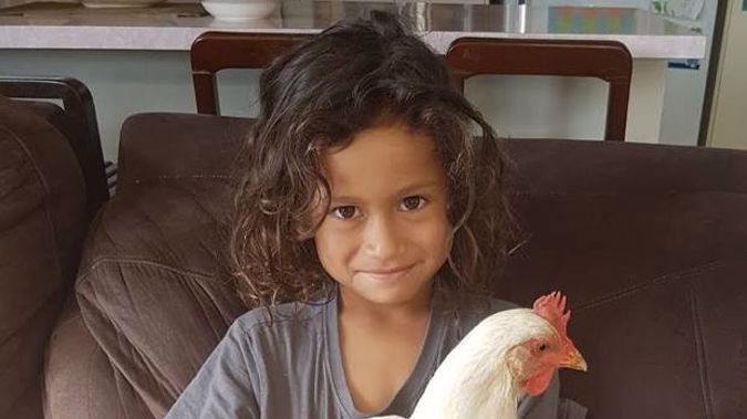 Eight-year-old Tohe Tatai with his pet chicken, Cheeka. Photo / supplied