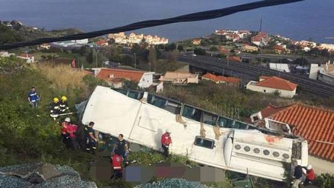 The bus is believed to have careered off a road on a bend and crashed down a hill on to a house. Photo / Twitter