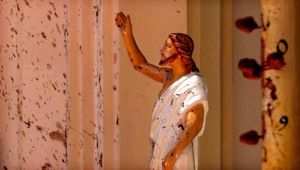 Blood stains are seen on the wall and on a Jesus Christ statue at the St. Sebastian's Church after blast in Negombo. Photo / AP.