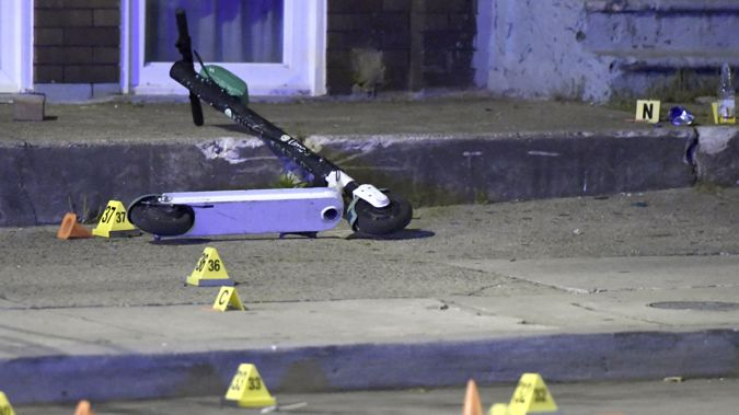 A scooter lies in the middle of the crime scene. (Photo / AP)