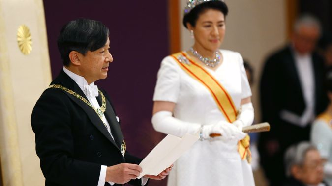 Emperor Naruhito, accompanied by new Empress Masako, makes his first speech in his new role. (Photo / AP)