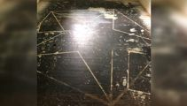 Home owners stunned by pentagram under the carpet
