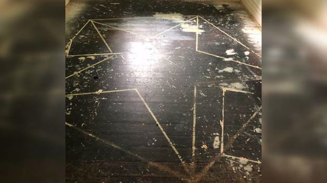 The pentagram was discovered when they were replacing the carpet. (Photo / Supplied)