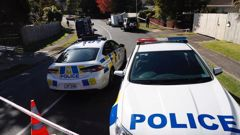 Police at the scene at a house on Weatherly Rd in Torbay. Photo / New Zealand Herald Photograph by Dean Purcell