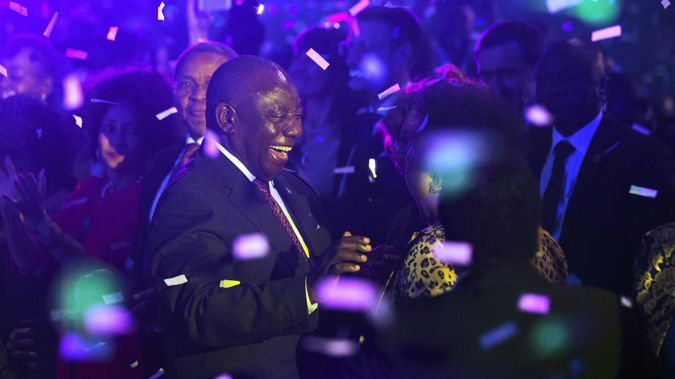 Cyril Ramaphosa celebrates his party's election victory. (Photo / AP)