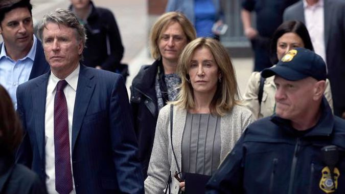 Felicity Huffman departs federal court with her brother Moore Huffman Jr on Monday, May 13 in Boston. (Photo / AP)